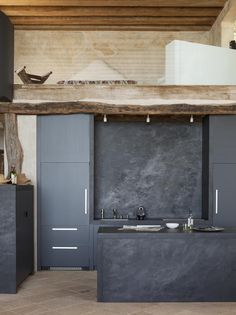 Dark grey, borderline black Kitchen and stone splash back and panel to the rear of the island. Modern Kitchen Design At The Richard Shapiro House