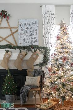 What a cute, yet simple flocked tree. And that beautiful pallet sign on the mantel. LOVE!! | A Traditional Christmas Home Tour at TheTurquoiseHome.com