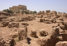Ruins of the ancient city of Babylonia in the foreground with one of Saddam Hussein's many palaces in the background.   The prophet Jeremiah foretold of Babylon's destruction hundreds of years before it happened:  Jeremiah 50:13 Because of the Lord's anger, Babylon will become a deserted wasteland. All who pass by will be horrified and will gasp at the destruction they see there.