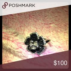Sterling Silver Black/White Diamond Flower Ring Boasts a stunning floral design with dazzling, diamond-encrusted petals Brings beautiful style to her every day Buffed to a brilliant luster Total stone count: 82 Diamond Jewelry Rings