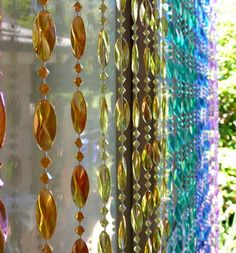 Iridescent Rainbow Swirl Beaded Curtain. This beaded curtain has iridescent acrylic beads in all of the colors of the rainbow and shines so beautifully... Beaded strands are easily removed from the ro