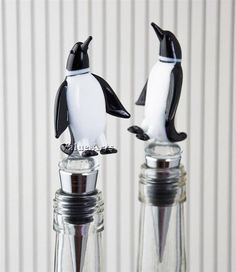 Our glass penguin wine bottle stopper is a cool and classy way to re-cork your wine. The hand crafted 2 inch tall solid glass penguin stands securely atop a 2 long stainless steel stopper wi All About Penguins, Penguins And Polar Bears, Penguin World, Wine Auctions, Penguin Love, Wine Bottle Stoppers, Wine Fridge, Stuffed Animals, Cool Stuff