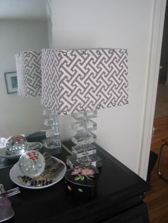 DIY lampshade covered with fabric & trimed with nailheads via little green notebook
