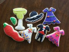 Mexican theme decorated sugar cookies.  Mariachi suit and hat, Mexican dresses, margarita, chili pepper