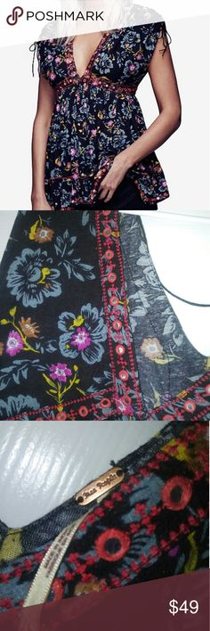 NWT $128 Free People Black Escapades Printed NWT $128 Free People Black Escapades Printed Peasant Top Size L. Very beautiful. Embellished v neck. Free People Tops Tunics