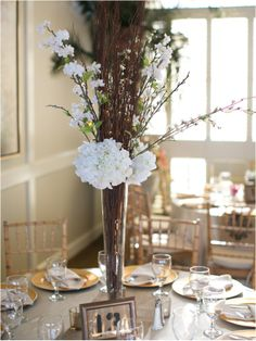 Rustic floral centerpiece ~ Photo: Sarah Ainsworth