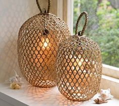 These would look cute on our front porch  pottery-barn-bamboo-lanterns