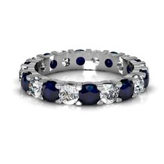 Shared prong sapphire and diamond ring.   LOVE.