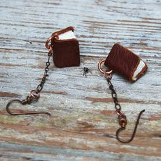 Miniature leatherbound book earrings that are both wearable and useable!