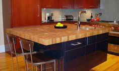 3 inch Plantation Teak Butcherblock Countertop in honey and brown colors with 1/8 inch Roundover edge profile and a Food Grade Oil finish. Special feature is an undermount sink. Designed by Venegas and Company LLC, Boston, MA.