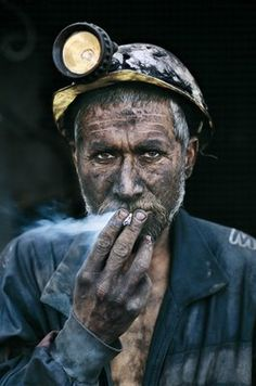 Coal Miner by Steve McCurry    Apparently I like smoking pictures...