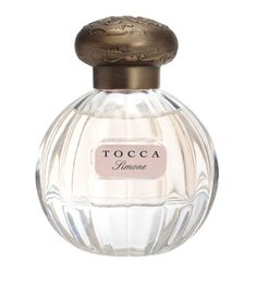 Tocca Simone Eau de Parfum | Waves crest along the white sand of Sydney's Bondi Beach, as the sea fills with surfers and swimmers alike. With sun-kissed hair and bronzed skin, the fearless young beauty dives into the fray. Sparkling notes of the tropical frangipani flower cut through the salt sea air, as Simone unfolds into creamy layers of watermelon, ylang ylang and blonde woods.