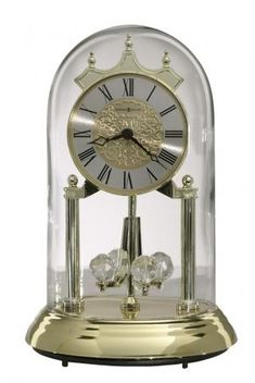 Found it at Clockway.com - Howard Miller 9in Brass Finished Anniversary Clock with Metal Base - CHM2494