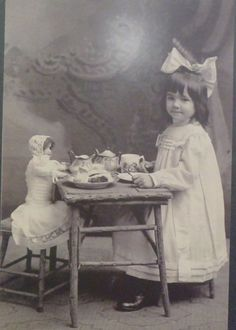 Antique Photo girl with big hair bow toy tea with bisque doll