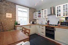 Expose brick, cream & white kitchen units
