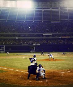 Hank Aaron's 715th home run in flight. Al Downing with the follow through on the mound.