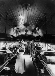 [Original reads: 'OFFICIAL PHOTOGRAPH TAKEN ON THE BRITISH WESTERN FRONT IN FRANCE. Interior of a ward on a British Ambulance Train in France.']