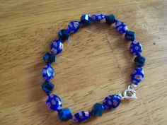 "7.5"" bracelet with blue glass flower beads and blue shimmer beads. by StrungOnLove on Etsy"