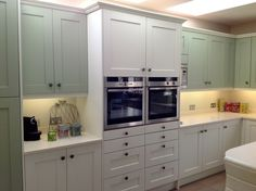 London N20 Painted Shaker finished in Sage and Strong White and 30mm Quartz Worktops