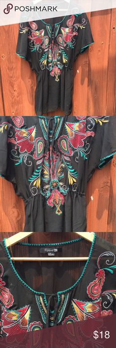 Embroidered Mexican style blouse Forever 21 Mexican style sheer tunic with elastic waist. Fun and beautiful. Forever 21 Tops