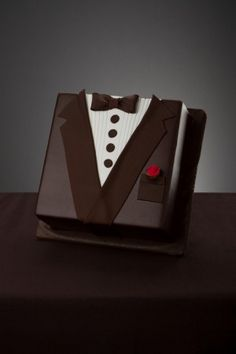 Groom's Cake. Would be cool to have a brides one as well and as the brides one would be white, have that vanilla flavoured and the groom one chocolate to cater for different tastes!!
