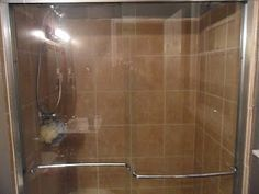 Cleaning Glass Shower Doors- don't waste your time with anything else but LEMON DUSTING SPRAY, not vinegar, not baking soda, not orange dusting spray, only the lemon one!!