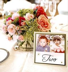 Table numbers for a wedding using pictures of bride and groom at the age of the table ehillgrove