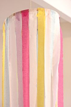crepe paper chandeliers: use an embroidery hoop and crepe paper (or even ribbon) and hang from the ceiling or a tree branch if outside. love this idea -- maybe for a baby/bridal shower or a girl's birthday party