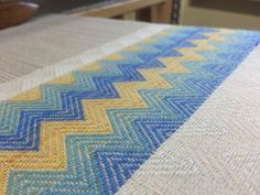 From the side on the loom