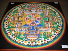 Photo of a Chenrezig Sand Mandala created and exhibited at the House of Commons on the occasion of the visit of the Dalai Lama on 21 May 2008.