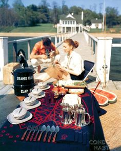 A private jetty picnic setting for House & Garden, 1952. Clams, anyone?   Photo by John Rawlings.