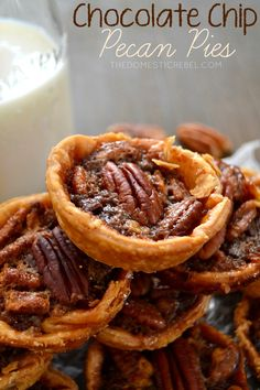 These Mini Chocolate Chip Pecan Pies are gooey, chewy treasures that are perfect for any dessert tray. Easy, foolproof and delicious!