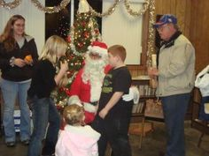 colin with santa at the mulberry firefighter's christmas party ;)
