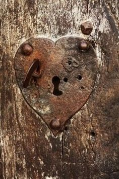 Metal doors with heart shaped lock. Abstract fine art photograph ...