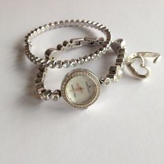 Anne Klein Glamour Gal Shiny Dainty Watch Perfect for a delicate lady. Which I am not lol. I am afraid I would ruin this sparkler. So dainty and delicate. Love it. All stones in place. There is no extender. See pic 4 for size. There is a scratch on face. You can see in pic 2. Needs a battery. Hope she finds a new happy home. Anne Klein Jewelry