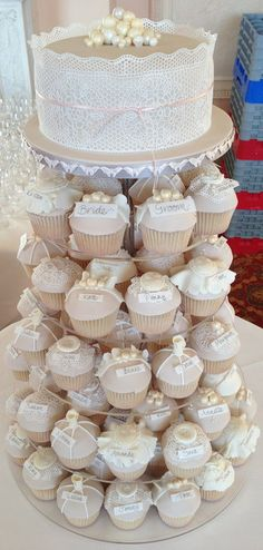 I think this is too cute. To have the names of the wedding party on the cupcakes. And then just have the cake on top .