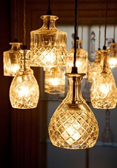 Real crystal decanters used as pendant lighting at the Conquine Bar in London