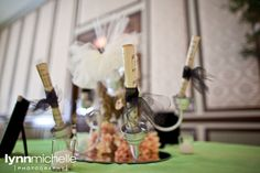 couture wedding, sheet music rolled up in black ribbon on vintage candle holder centerpiece.