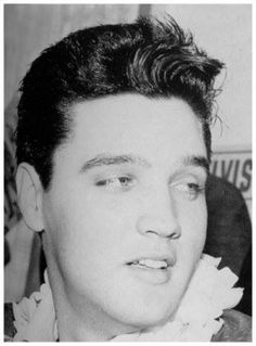 Elvis leaving the press conference held for benefit concert (USS Arizona Memorial)  at the Hawaii Village Hotel, Honolulu, Hawaii, March 25, 1961