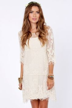 Live for Today Cream Crochet Dress. Three tiers of crocheted netting form a lovely shift shape that's accented with intricately crocheted flowers that form a statement-making, fringe trim along the hemline and three-quarter length, slightly belled sleeves. $72.00