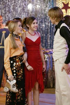 "Miley Cyrus, Emily Osment and Cody Linley. As Miley Stewart, Lily Truscott and Jake Ryan in Hannah Montana. Season 1, Episode 15 ""More Than a Zombie to Me"". Premiered September 8, 2006"