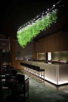 Look at this glowing neon green piece that totally lights up this bar space...Truly a relaxing and mellow piece that doesn't take too much away from the low key ambiance of the venue. #interiordesign #alanmizrahilighting