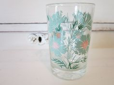Vintage Retro Swanky Swig Juice Glass Turquoise Aqua Flowers Shabby Chic Cottage Style Votive Candle. $3.95, via Etsy.