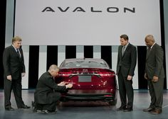 Toyota Division Group Vice President & General Manager Bob Carter (left to right), Calty Design President Kevin Hunter and Toyota Motor Manufacturing Kentucky President Wil James watch as Chief Engineer Randy Stephens badges the 2013 Avalon after its reveal at the 2012 New York International Auto Show, Thursday, April 5, 2012. Photo: Joe Polimeni
