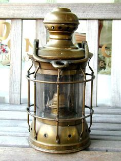 click to view larger image of A late 19th Century American Ships Lamp with Mounting Bracket circa 1890