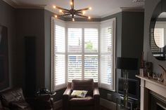 Full Height Shutters in a Bay Window in the Living Room #stylish #shutters for a stylish #livingroom in #peckham!!! Find out more on our website #interiordesign #homedecor