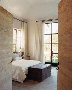 Iron windowed doors |  Bedroom of Alexandra and Michael Misczynski.
