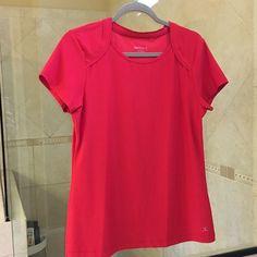 Danskin athletic shirt Size L. Never worn. Danskin Tops Tees - Short Sleeve