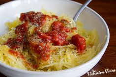Spaghetti Squash with Tomato Sauce and Parmesan Cheese | Only 88 Calories | Satisfying, Indulgent & Healthy | For MORE RECIPES, fitness & nutrition tips please SIGN UP for our FREE NEWSLETTER www.NutritionTwins.com