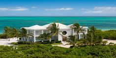 Beach Villa Oceanus, GRACE BAY BEACH, PROVIDENCIALES (PROVO) / TURKS AND CAICOS ISLANDS - modern, contemporary, beachfront villa with infinity-edge swimming pool, 4 king bedrooms (+2 bonus rooms) and absolutely magnificent views!
